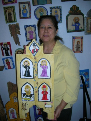 Theresa Montoya shows off one of husband Richard's retablos depicting Beatles songs,