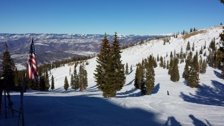 Scattered pines and rolling terrain lend character to the ski runs at Snowmass Mountain. Craigslegz.com
