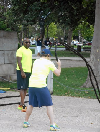 A trainer conducts a fitness class next to the statue of Rocky outside the Philadelphia Museum of Art. Craigslegz.com