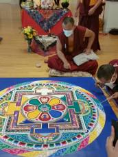 Photo gallery from the Dissolution Ceremony of the monks' 2017 Sacred Art Tour at Coral Springs Museum of Art by Fran Davis. Here the monks are nearing completion of the manada, which is created by vibrating a tool against metal cones to release a few grains of sand at a time,