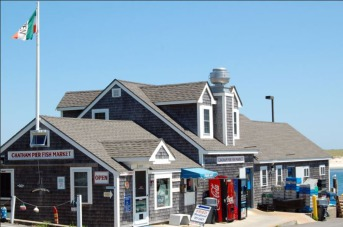 The Chatham Pier Fish Market is a popular gathering spot in afternoons when commercial fishermen unload their catch.